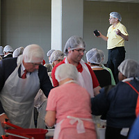 Thomas Wells | BUY at PHOTOS.DJOURNAL.COM<br /> Leon Sporrer lets the group know they have packaged over 5,000 bags of food during Friday's food drive at the BancorpSouth Arena in Tupelo.