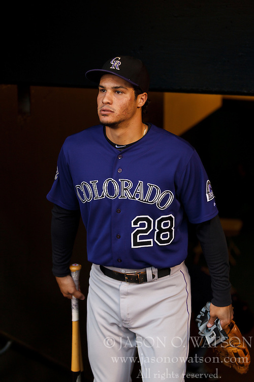 SAN FRANCISCO, CA - SEPTEMBER 09: Nolan Arenado #28 of the Colorado Rockies enters the dugout before the game against the San Francisco Giants at AT&T Park on September 9, 2013 in San Francisco, California. The San Francisco Giants defeated the Colorado Rockies 3-2 in 10 innings. (Photo by Jason O. Watson/Getty Images) *** Local Caption *** Nolan Arenado