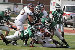 28 September 2013:  Shawn Jackson is forced to the turf by Connor Klein, Joe Schneider and Gary Eppinger during an NCAA division 3 football game between the Hope College Flying Dutchmen and the Illinois Wesleyan Titans in Tucci Stadium on Wilder Field, Bloomington IL