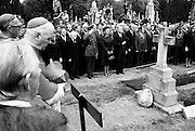 Taoiseach and Mrs Liam Cosgrave among the political and Church dignitaries at the graveside of Eamon de Valera as he is buried in Glasnevin cemetery. A founder of Fianna Fail, he served several terms as Taoiseach, then became the third President of Ireland in 1959, re-elected in 1966. At his retirement in 1973 at the age of 90, he was the oldest head of state in the world.<br />