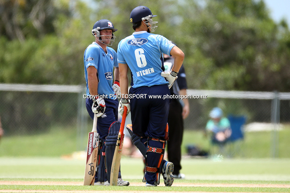 Gareth Hopkins and Anaru Kitchen. Men's one day cricket, Auckland Aces v Wellington Firebirds, Colin Maiden Park, Auckland. Wednesday 12 January 2011. Photo: Ella Brockelsby/photosport.co.nz