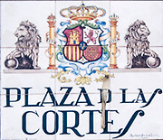 Plaza de las Cortes (Cuts). Ceramic street sign in Madrid, Spain
