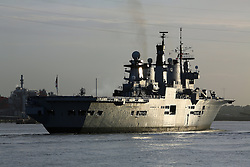 © Licensed to London News Pictures. File pic dated 14/05/2013. London, UK. HMS Illustrious leaving london up The Thames river. The government has announced that HMS Illustrious is heading to the Philippines to help with the Typhoon Haiyan recovery efforts. Photo credit : Rob Powell/LNP