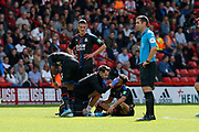 Andros Townsend of Crystal Palace receives treatment for a head injury during the Premier League match between Sheffield United and Crystal Palace at Bramall Lane, Sheffield, England on 18 August 2019.