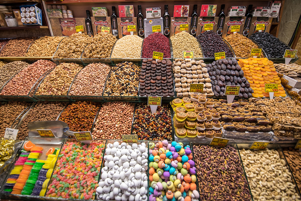 Neatly organized bins at Istanbul Spice bazaar in Turkey are brimming with sweets, nuts and dried fruits for customers to purchase