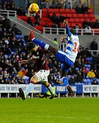 Mile Jedinak (15) of Aston Villa is challenged by Sone Aluko (14) of Reading during the EFL Sky Bet Championship match between Reading and Aston Villa at the Madejski Stadium, Reading, England on 2 February 2019.