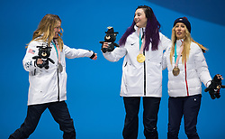 March 12, 2018 - Pyeongchang, South Korea - Gold medalist Brenna Huckaby of the US, center, celebrates with teammate Amy Purdy (silver) and Cecile Hernandez of France (bronze) during a medal ceremony for Women's Snowboard Cross Monday, March 12, 2018 at the Medals Plaza for the 2018 Pyeongchang Winter Paralympic Games. Photo by Mark Reis (Credit Image: © Mark Reis via ZUMA Wire)