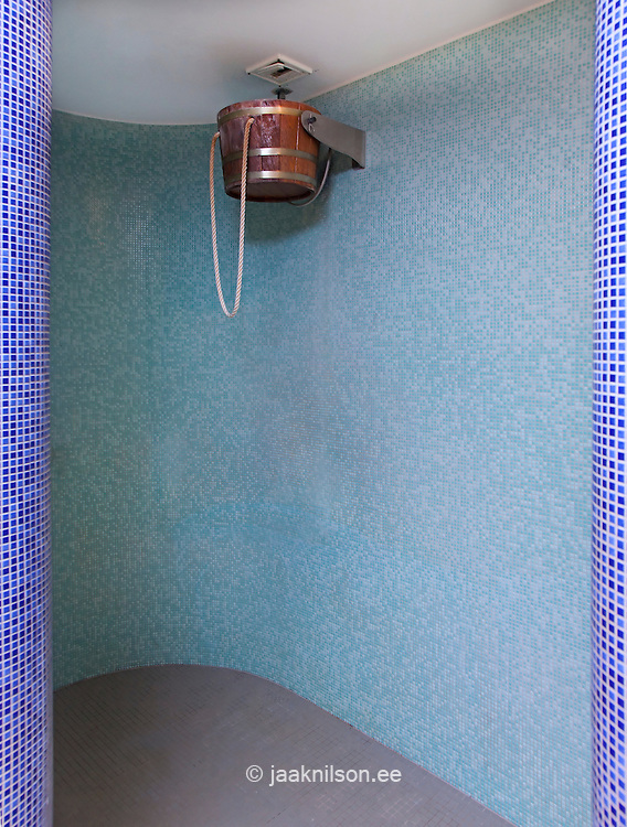 Wet room cubicle for cold shower. Tilting water bucket in Viimsi Spa Hotel sauna in Tallinn.
