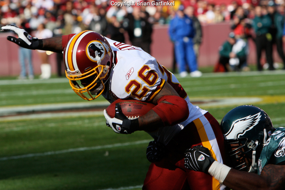 LANDOVER, MD - NOVEMBER 11: Philadelphia Eagles Defensemen brings down a Washington Redskin on November 11, 2007 at FedEx Field in Landover, Maryland. The Eagles won 33-25.