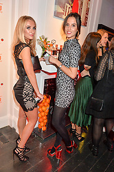 Left to right, TIFFANY WATSON and LUCY WATSON at the Cointreau launch for Yumi by Lilah Parsons SS/16 collection held at 15 Bateman Street, London on 1st December 2015