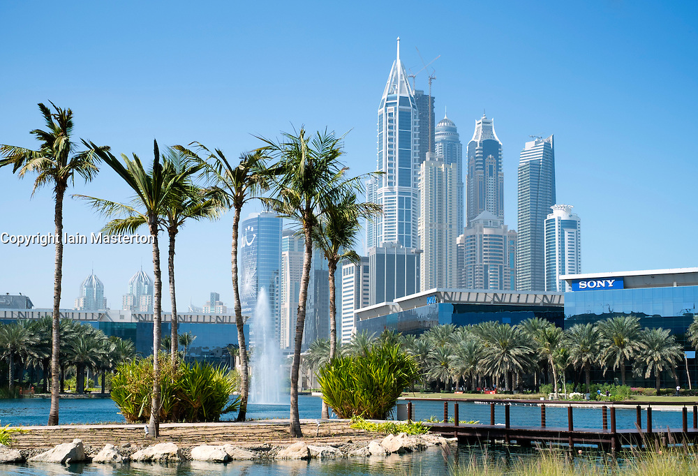 office buildings and landscaped park and lake  at Dubai Internet City in United Arab Emirates UAE