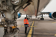 Emmanuel , an aircraft inspector checks a plane. With one order, they can immobilise a Boeing or delay the taking off for 300 passengers on an intercontinental flight. When Operating Technical Inspectors (CTE) get aboard , it is always in pairs and always unexpected. Emmanuel Lain&eacute; controls an international flight to Taipei and a cargo plane bound for Lebanon.<br /> <br /> D&rsquo;un ordre, ils peuvent immobiliser un Boeing ou retarder le d&eacute;collage des 300 passagers d&rsquo;un long courrier. Quand les contr&ocirc;leurs techniques d&rsquo;exploitation (CTE) d&eacute;barquent, c&rsquo;est toujours en bin&ocirc;me et toujours &agrave; l&rsquo;improviste. Emmanuel Lain&eacute; passe au crible un vol international pour Taipei et un avion de fret en partance pour le Liban.