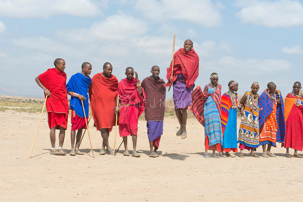 Maasai people jumping and dancing.  Amboseli, Kenya.