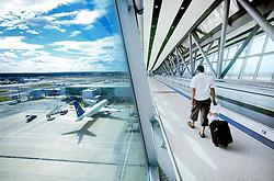 Gatwick Airport, airside, split view of new passenger bridge interior and surrounding apron, July 2005, Ref CGA01093d, A.C