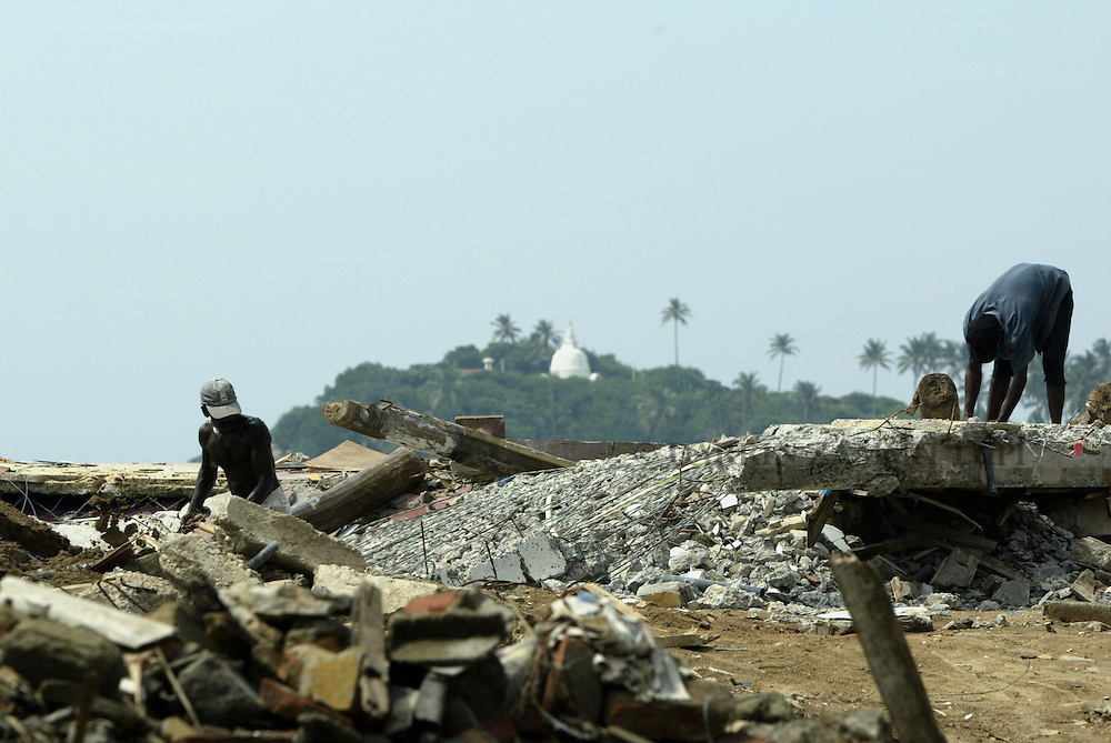 Two men clean up the area where their home once stood in the tsunami-devastated town of Galle on the south west coast of Sri Lanka on January 13, 2005..Photo by Darrin Zammit Lupi