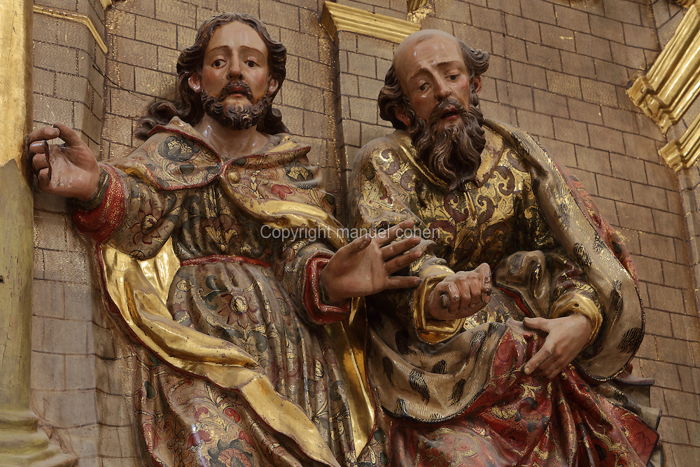 St Joseph and St Joachim, from the Baroque altarpiece of St Joseph and St Joachim, in gilded polychrome wood, in front of the gilded door of the Chapel of St Cosmas and St Damian, 15th century, dedicated to St Anne and St Joachim, parents of the Virgin, in the Cathedral of St Mary, designed by Benito Dalguayre in Catalan Gothic style and begun 1347 on the site of a Romanesque cathedral, consecrated 1447 and completed in 1757, Tortosa, Catalonia, Spain. The cathedral has 3 naves with chapels between the buttresses and an ambulatory with radial chapels. Picture by Manuel Cohen