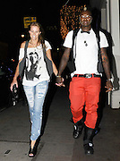 01.JULY.2009 - LONDON<br /> <br /> DJIBRIL CISSE WALKING THROUGH MAYFAIR WITH HIS WIFE JUDE LITTLER.<br /> <br /> BYLINE: EDBIMAGEARCHIVE.COM<br /> <br /> *THIS IMAGE IS STRICTLY FOR UK NEWSPAPERS & MAGAZINES ONLY*<br /> *FOR WORLDWIDE SALES & WEB USE PLEASE CONTACT EDBIMAGEARCHIVE - 0208 954 5968*