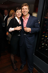 DARCEY BUSSELL and ANGUS FORBES at a St.Valentine's dinner hosted by Ruinart champagne at Tom Aikens Restaurant, Elystan Street, London on 6th February 2007.<br />