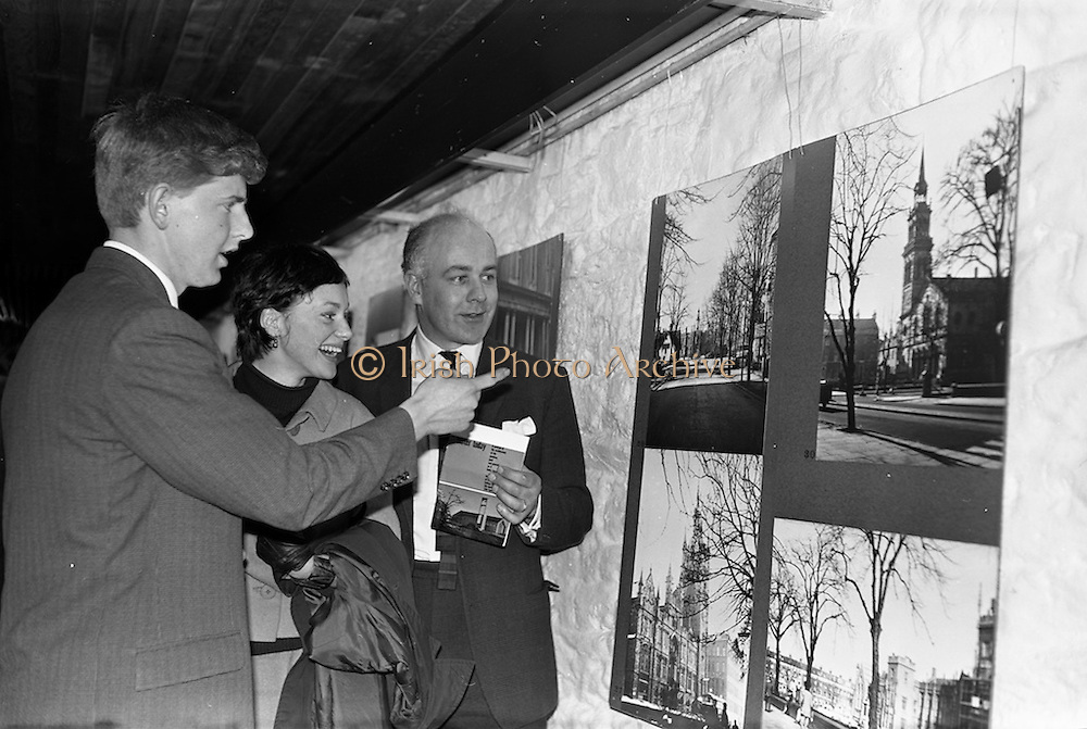 """05/04/1963<br /> 04/05/1963<br /> 05 April 1963<br /> Opening of """"Ulster Today"""" architectural photographic exhibition.Organised by the Royal Society of Ulster Architects opened at the Gallery of the Building Centre of Ireland  in Dublin in the presence of Donagh O'Malley, Parlimentary Secretary to the Minister for Finance and Sir Ian MacLennan, British Ambassador to Ireland. The exhibition was later displayed in Belfast. Picture shows:Robert Mckinstry (right) convenor of the exhibition committee;  Ann McGraw (Belfast) and Michael Porter of Belfast who took half of the photographs at the exhibition."""