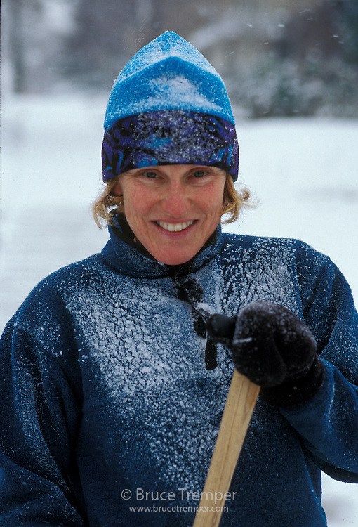 Susi Hauser shovels snow