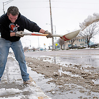 121714       Adron Gardner/Independent<br /> <br /> Thomas Piano shovels snow from the sidewalk of the New Mexico Pottery Company in Gallup Wednesday.