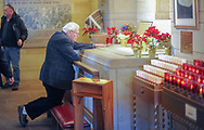A man places his hand on the tomb as he prays at the National Shrine of St. Katharine Drexel Thursday, December 28, 2017 in Bensalem, Pennsylvania. Drexel was an American heiress who dedicating herself to work among the American Indians and African-Americans in the western and southwestern United States. She was canonized a saint by the Roman Catholic Church in 2000. (Photo by William Thomas Cain/Cain Images)