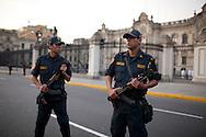 Police stand guard outside the Palacio de Gobierno on Saturday, Apr. 11, 2009 in Lima, Peru.