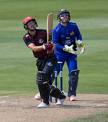 Canterbury's Chad Bowes, left, hits a ball skyward as Otago Volts' Derek de Boorder looks on in the Ford Trophy one-day domestic cricket match at the University of Otago Oval, Dunedin, New Zealand, Saturday, January 27, 2018. Credit:SNPA / Adam Binns ** NO ARCHIVING**