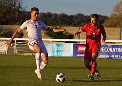 BANGOR, WALES - Monday, October 15, 2018: Wales' Brandon Cooper (R) an Poland's Hubert Sobol (L) during the UEFA Under-19 International Friendly match between Wales and Poland at the VSM Bangor Stadium. (Pic by Paul Greenwood/Propaganda)