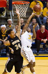 West Virginia Mountaineers guard Juwan Staten (3) shoots over Wofford terriers forward Lee Skinner (34) during the first half at the WVU Coliseum.