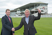 02/08/2015  Last day in the hot seat for John Moloney  at Galway Race Course  after 26 years in charge.  Michael Moloney who will take over from John congratulates his father .  Photo:Andrew Downes