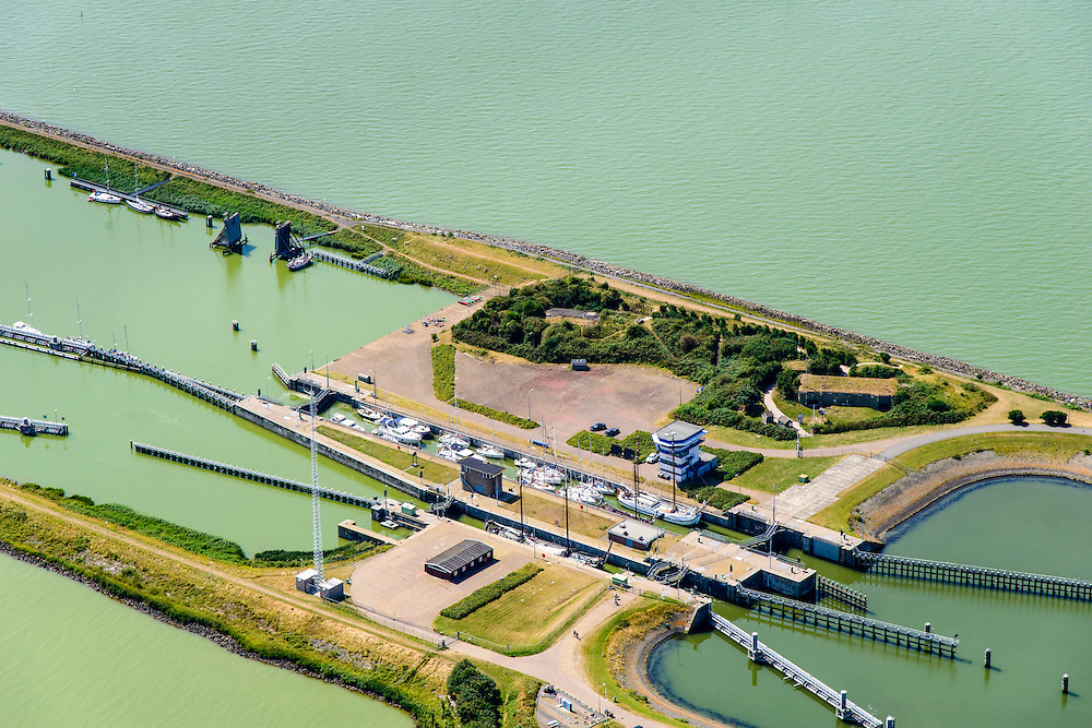 Nederland, Friesland, Kornwerderzand, 05-08-2014; Afsluitdijk met sluizencomplex. IJsselmeer.<br /> Enclosure Dam near the Frisian coast. Sluices and locks. <br /> <br /> luchtfoto (toeslag op standaard tarieven);<br /> aerial photo (additional fee required);<br /> copyright foto/photo Siebe Swart.