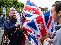 Man selling union jack flags at  Orange Walk parade in central Glasgow , Scotland, United Kingdom