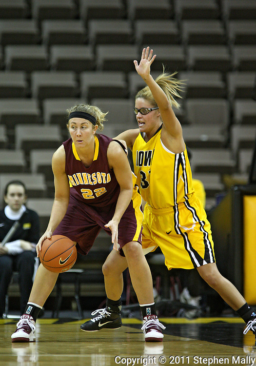 February 10 2011: Minnesota Golden Gophers forward Kristen Dockery (22) works with the ball as Iowa Hawkeyes guard/forward Hannah Draxten (31) defends during the first half of an NCAA women's college basketball game at Carver-Hawkeye Arena in Iowa City, Iowa on February 10, 2011. Iowa defeated Minnesota 64-62.