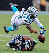 Carolina Panthers defensive back Robert McClain (27) breaks up a pass intended for Seattle Seahawks wide receiver Doug Baldwin (89) during the second half of an NFL divisional playoff football game, Sunday, Jan. 17, 2016, in Charlotte, N.C. (AP Photo/Mike McCarn)