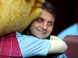 Aston Villa Manager, Tim Sherwood reluctantly receives a hug from the villa mascot  - Photo mandatory by-line: Joe Meredith/JMP - Mobile: 07966 386802 - 21/03/2015 - SPORT - Football - Birmingham - Villa Park - Aston Villa v Swansea City - Barclays Premier League