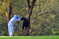 © Licensed to London News Pictures.03/11/2017.<br /> PENGE, UK.<br /> POLICE FORENSICS AT THE SCENE, TAKING PICTURES OF A COAT HANGING IN A TREE.<br /> A Murder investigation has been launched following a fatal stabbing in Penge at Betts Park, Anerley Road,<br /> Police were called at 19.22 hrs on Thursday 2 November to Betts Park,Penge near Bromley to reports of a male having been attacked. The victim was pronouced dead at the scene. The park is closed off by police.<br /> Photo credit: Grant Falvey/LNP