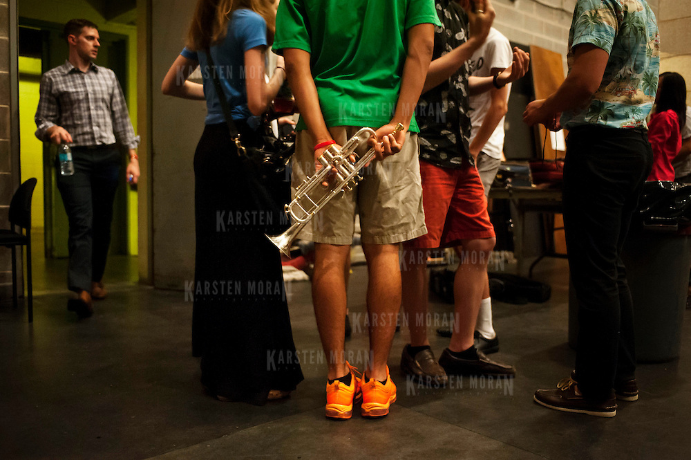 July 9, 2013 - Purchase, NY : Members of the National Youth Orchestra of the United States of America including trumpeter Lincoln Valdez (from Austin, TX.), in orange shoes, congregate backstage as they prepare for rehearsal with conductor Valery Gergiev (not pictured) at SUNY Purchase's Performing Arts Center in Westchester on Tuesday afternoon. The Orchestra, a new project of Carnegie Hall's Weill Music Institute, is comprised of musicians aged 16-19, hand-picked from across the country. The program -- and orchestra -- will kick off its inaugural season with a performance at SUNY Purchase on Thursday evening, and then head off to perform in Washington DC,  Moscow, St. Petersburg, and London.  CREDIT: Karsten Moran for The New York Times
