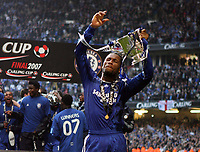Photo: Rich Eaton.<br /> <br /> Chelsea v Arsenal. Carling Cup Final. 25/02/2007. Man of the match  Didier Drogba celebrates winning the cup by 2 goals to 1