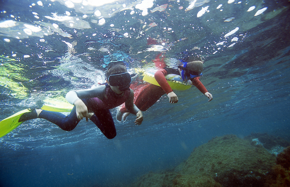 Young divers exploring the sea . The youngest one can't even swim, but he like to explore!  Location: The Azore Island