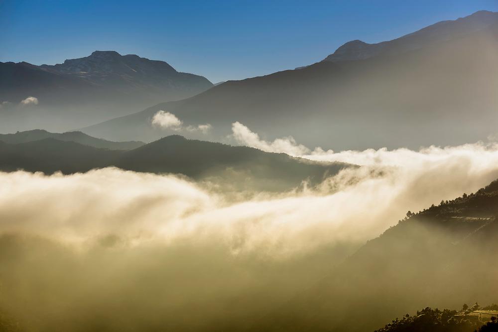 High Atlas Mountains with morning fog, Morocco.