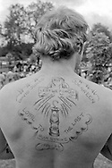 Shaun Webster, Cortonwood, with his tattoo to commemorate the 1984-85 miners strike. Yorkshire Miner's Gala. Rotherham 1985.