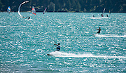 """Parasurfers play on Lake Silvaplana in Upper Engadine, in Graubünden (Grisons) canton, Switzerland, the Alps, Europe. The Swiss valley of Engadine translates as the """"garden of the En (or Inn) River"""" (Engadin in German, Engiadina in Romansh, Engadina in Italian)."""