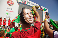Portuguese supporter celebrating while wearing a mask depicting Cristiano Ronaldo,  while   awaiting for the football team to arrive at Alameda Dom Afonso Henriques, in Lisbon. Portugal's national squad won the Euro Cup the day before, beating in the final France, the organizing country of the European Football Championship, in a match that ended 1-0 after extra-time.