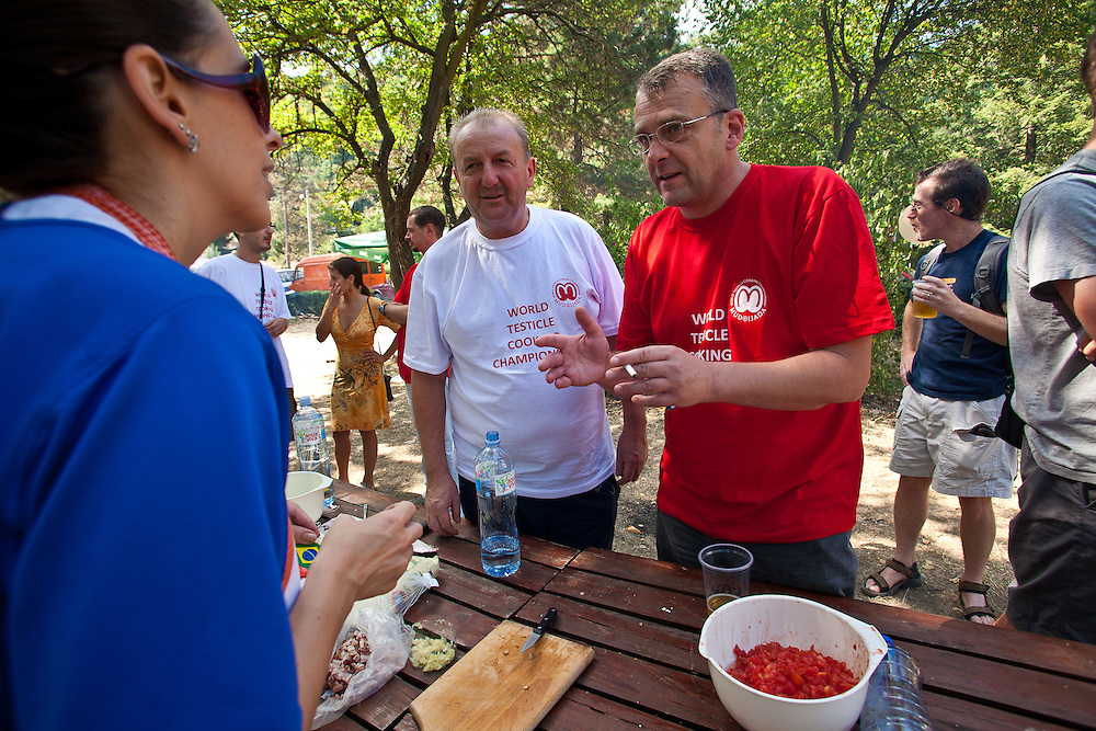 Festival founder Ljubomir Erovic (R) visiting the Brazilian table at the 2011 World Testicle Cooking Championship, Ovcar Banja, Serbia.