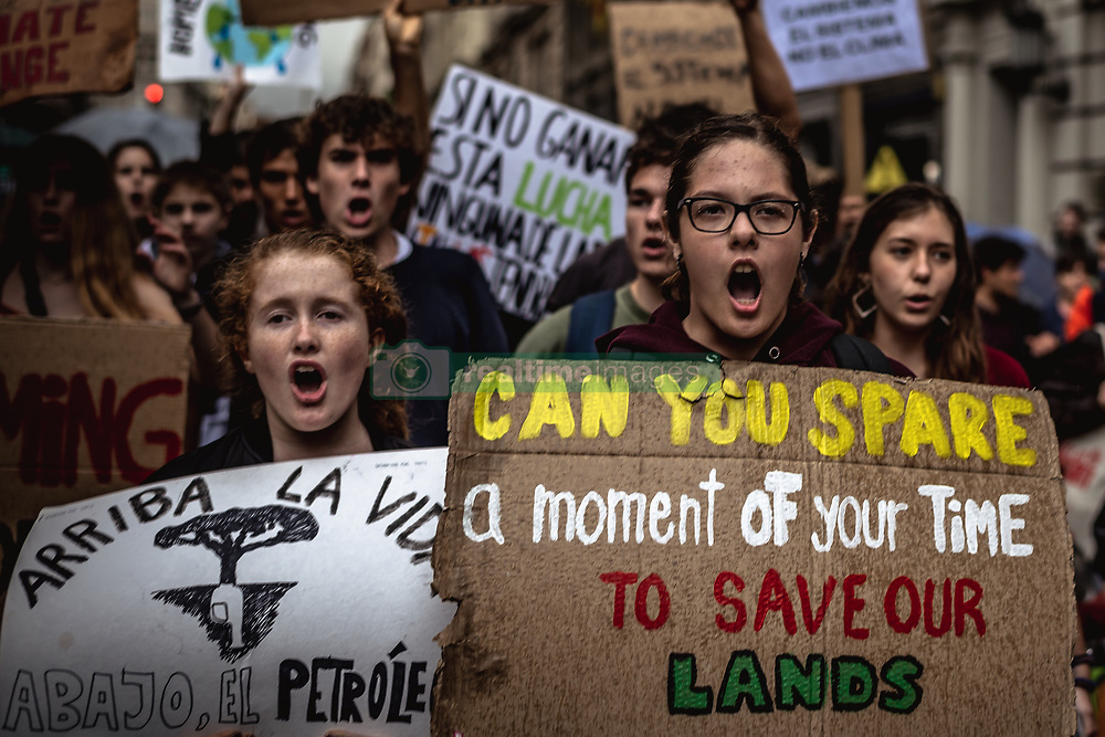May 24, 2019 - Barcelona, Catalonia, Spain - Protestors shout slogans demanding climate change action during the second global 'Fridays For Future' climate strike. The protest is part of a global movement inspired by Swedish school girl Greta Thunberg. (Credit Image: © Matthias OesterleZUMA Wire)
