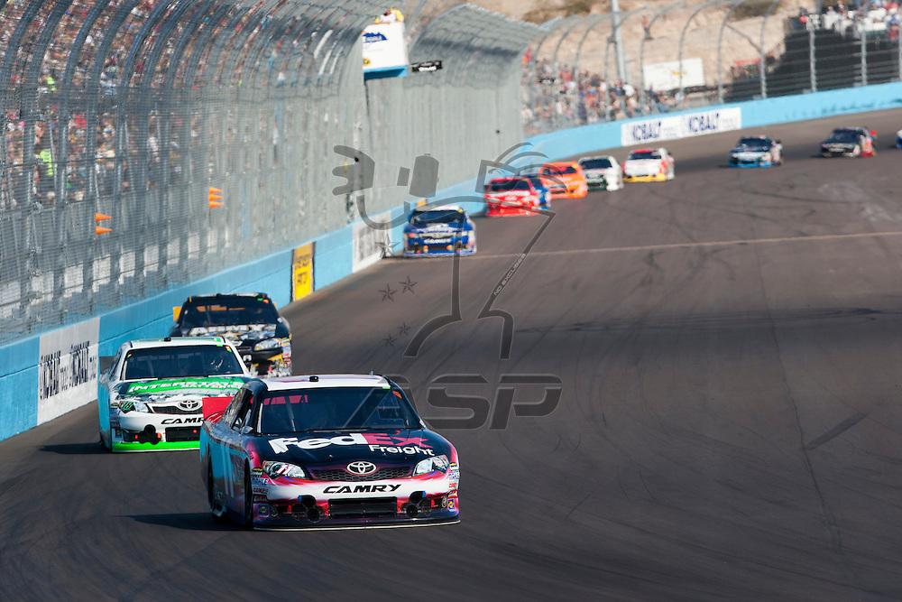 Avondale, AZ - NOV 13, 2011:  Denny Hamlin (11) races for the Kobalt Tools 500 race at the Phoenix International Raceway in Avondale, AZ.