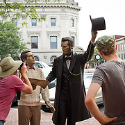 Tourists take pictures of the Abraham Lincoln statue in downtown Gettysburg, PA, during the Sesquicentennial Anniversary of the Battle of Gettysburg, Pennsylvania on Sunday, June 30, 2013.  A pivotal moment in the Civil War, over 50,000 soldiers were killed, wounded or missing after 3 days of battle from July 1-3, 1863.  Later that year, President Abraham Lincoln returned to Gettysburg to deliver his now famous Gettysburg Address to dedicate the cemetery there for the Union soldiers who died in battle.  John Boal photography