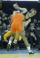 January 07, 2011: Oklahoma State's Albert White tries to score a takedown again Iowa's Nick Moore during the 157-pound bout in the NCAA wrestling dual between the Oklahoma State Cowboys and the Iowa Hawkeyes at Carver-Hawkeye Arena in Iowa City, Iowa on Saturday, January 7, 2012. White won 7-4.