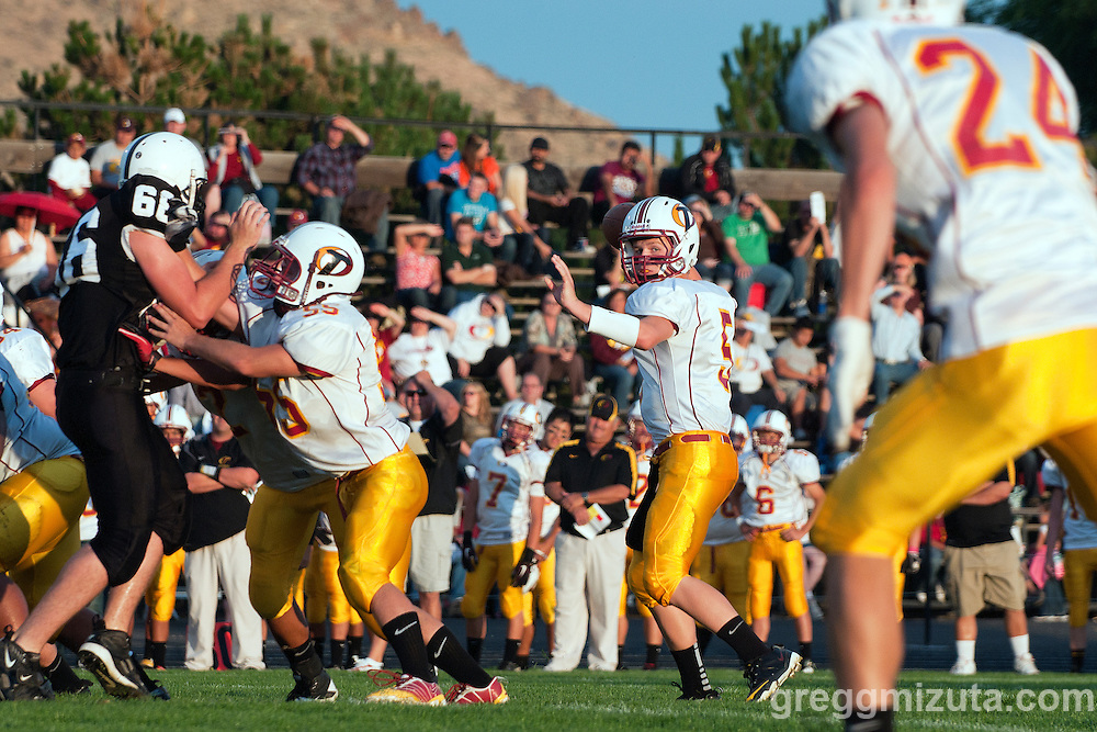 Ontario quarterback Trampis Waite set to pass to Joseph Delgado during the Tigers 44-0 victory against Vale on September 16, 2011 in Vale, Oregon.